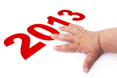 2013 new year and Baby Hand Stock Image