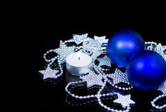 2013 New Years Party Background. Balls, stars garland and light candle Stock Photos