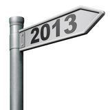 2013 next new year. Road sign near future coming up isolated on white Stock Image
