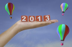 2013 on palm. 2013 red cube on lady palm Stock Photos