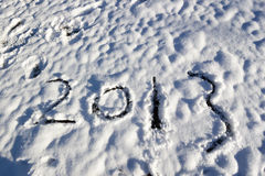 2013 in the snow. The year 2013 written in snow stock image