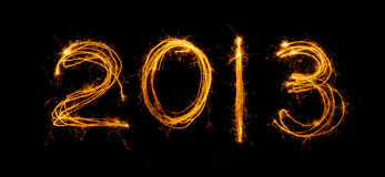 2013 written in sparklers royalty free stock images
