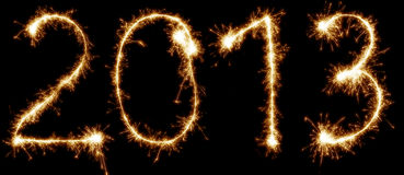 2013 written with sparkles. Isolated on black background Stock Photography