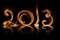 2013 year in fire. With sparkles on black royalty free illustration