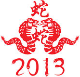 2013 year of snake. The design of Chinese paper cut art represent the new year 2012 the year of snake concept Stock Image