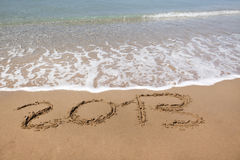 2013 year wrote on the beach, with copy space Royalty Free Stock Images