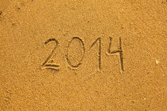 2014 written in sand on beach Royalty Free Stock Image
