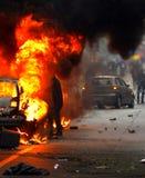 Экспо 2015: Черные автомобили комплектов блоков на огне Стоковое Изображение
