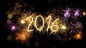 新年2016年闪烁发光物标志和烟花 库存图片