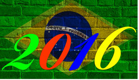 2016 Rio, Brazil. Flag of Brazil on brick wall background in graffiti style Royalty Free Stock Photo