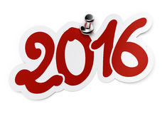 2016 two thousand sixteen. 2016 (two thousand sixteen) red sticker fixed onto a white background by using a thumbtack Royalty Free Stock Photos