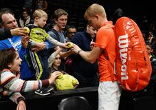 2020 New York Open tennis tournament Champion Kyle Edmund of Great Britain signs autographs after his final match victory