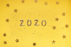 Free 2020 Numbers From Small Confetti With Shining Stars . Festive Background. New Year. Top View. Royalty Free Stock Photo - 159927425