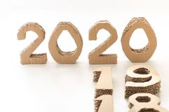 Free 2020 With 19 And 18 Down, Handmade 3D Numbers Made Of Reused Cardboard Paper, On White Background. New Year Concept. Royalty Free Stock Photos - 129333218
