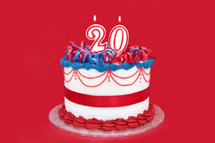 20th Cake. Number 20 celebration cake, with vibrant red background.  Suitable for birthday, anniversary, or any other special celebration Stock Photography