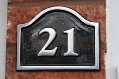 21. Black and silver house number twenty one sign Royalty Free Stock Photos