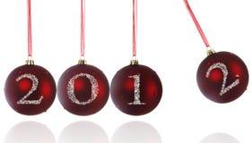 2012 on christmas balls. 2012 on Newtons Cradle Christmas ball Royalty Free Stock Image