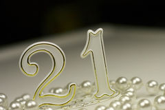 21st Birthday sign. Surrounded by pearls, a celebratory concept Royalty Free Stock Photography