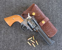 22 caliber revolver. 22 caliber Single Sixrevolver with bullets and holster Royalty Free Stock Photography