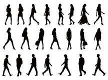 22 people silhouettes collection. Over twenty young people silhouettes. Perfect body proportions, long legs. Black vector illustration over white background Royalty Free Stock Photo