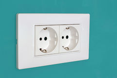 220v Power outlet on green glass Stock Images