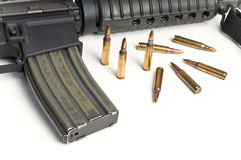 223 Bullets with M16 style Military Assault Rifle. Isolated on white background royalty free stock photo