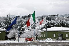 235 Training Regiment Volunteers italian flag. Ascoli Piceno, Italy  - February 02: 235° Training Regiment Volunteers Piceno the main square of the base with Royalty Free Stock Photography