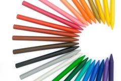 24个c颜色用蜡笔画形状 库存照片