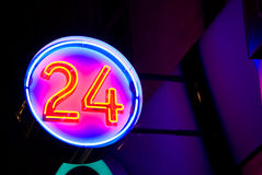 24. Neon signboard 24 lighting in the night Royalty Free Stock Images