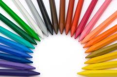 24 crayons de couleur aiment un Soleil Levant Photographie stock libre de droits