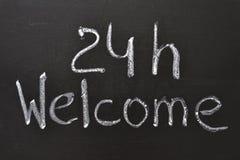 24 H-välkomnande Arkivbild