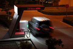 24 hour ATM. Car at 24 hour ATM at night Stock Photos