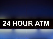 24 Hour ATM sign. Light up at night royalty free stock image