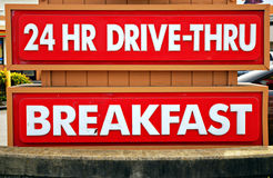 24 Hour Drive-Thru. And Breakfast sign at a fast food restaurant stock image