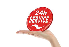 24 hour service. A neat human hand holding a stylized sign that offers a 24 hour service. All isolated on white background Stock Photos