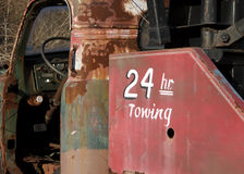 24 Hour Towing. Old Tow Truck with 24 Hour Towing Stock Photo