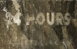 24 hours grunge background. 24 hours grunge textured background with copy space stock photography