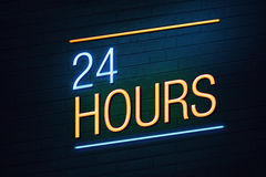24 hours neon sign for shop. Blue and orange neon sign with 24 hours text on wall Stock Photo