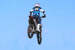 24 jumping. Big jump at motocross race Royalty Free Stock Images