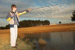 24 som flyfishing Arkivfoton