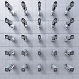 25 cctv camera watching you. On concrete wall Royalty Free Stock Photography