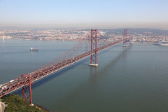 The 25 de Abril Bridge in Lisbon Royalty Free Stock Photography