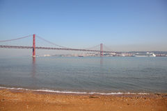 The 25 de Abril Bridge in Lisbon Royalty Free Stock Images