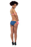 25 years young woman in swimsuit with american flag Royalty Free Stock Image
