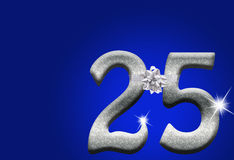 25th Anniversary. The numbers 25 in silver with ribbon and bow on a blue background, 25th anniversary Stock Images