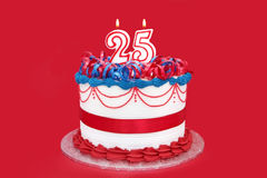 25th Cake. Twenty-fifth celebration cake ~ number candles on cake with vibrant red background.  suitable for birthday, anniversary, or any other celebration Stock Photos