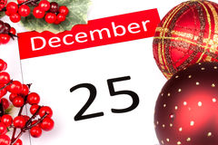 25th December. Calendar Date of 25 December with seasonal holly and red berries Stock Photos
