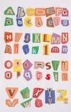 26 lettere sul documento di colore Immagine Stock Libera da Diritti