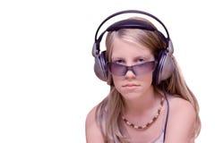 新女孩的耳机 免版税图库摄影