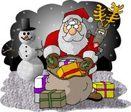 检查礼品的袋子他的圣诞老人 图库摄影